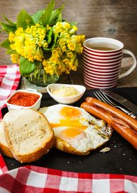 foto of pommes de terre frites  - Lunch time with eggs and fried sausages - JPG
