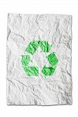 Recycle Symbol On Wrinkled Paper Isolated On White Background