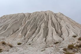 image of feldspar  - Mountain made from macadam and sand in open - JPG