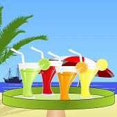 A waiter brings fruit juices on the beach