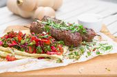 Постер, плакат: Kebab traditional Oriental Meat Kebab Of Minced Beef Or Lamb With Vegetables And Herbs Overhead Mar