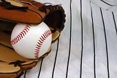 Baseball in a glove on a uniform.