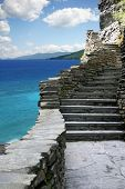 Stairway rising along the coast of a tropical beach.