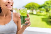 Green smoothie healthy lifestyle fitness woman drinking spinach juice cleanse in summer background a poster