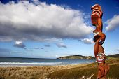 stock photo of maori  - Maori carving guarding Omaha beach New Zealand - JPG
