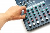 Hand and sound mixing console. Element of design.