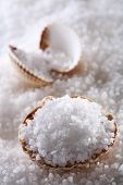 sea salt in sea shell on salts and second shell background