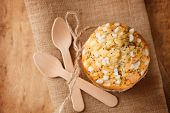 poppy seed muffin in rustic style, top view shallow dof