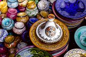 decorated tagine and traditional morocco souvenirs in medina souk