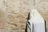 A Men is Praying At The Wailing Wall (western wall) , Jerusalem, Israel