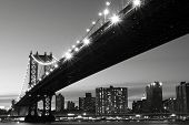 image of new york skyline  - New York City Skyline and Manhattan Bridge At Night - JPG