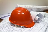 plans with construction helmet