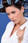 Woman wearing hair rollers