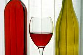 Red & White Wine Bottles With Wine Glass