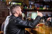 Bar Is Relaxing Place To Have Drink And Relax. Man With Beard Spend Leisure In Dark Bar. Hipster Rel poster
