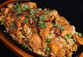 Chicken tikka biriyani in a cast iron sizzler dish