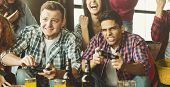 Happy Young Friends Playing Video Games In Loft. Have Fun Playing Video Games Concept poster