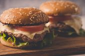 Hamburger Or Sandwich On Brown Paper. Delicious Sandwich Hamburger With Meat, Cheese And Fresh Veget poster