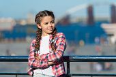 Sunny Day Walk. Leisure Options. Free Time And Leisure. Girl Cute Kid With Braids Relaxing Urban Bac poster