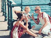 Mother And Father With Son Eat Ice Cream At Sea. Summer Vacation Of Happy Family. Child With Father  poster