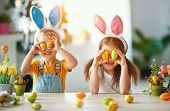 Happy Easter! Funny Funny Children Boy And Girl With Ears Hare Getting Ready For Holiday poster