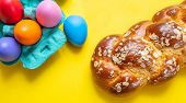 Easter Eggs And Tsoureki Braid, Greek Easter Sweet Bread, On Yellow Color Background poster