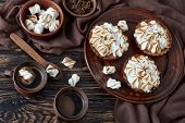 Lemon Meringue Chocolate Mini Pies With Browned Meringue Peaks Served With Coffee, Mini Marshmallows poster