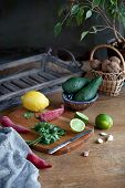 Cooking Mexican Food  Guacamole - Avocado, Lime, Lemon, Pepper, Garlic And Cilantro On A Wood Table. poster