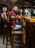 Hipster Brutal Bearded Man Spend Leisure With Friend At Bar Counter. Men Relaxing At Bar. Friday Rel poster