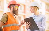 Foreman Established Supply Of Building Materials. Expert And Builder Communicate About Supply Buildi poster