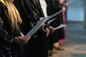 Choir Singers Holding Musical Score And Singing On Student Graduation Day In University, College Dip poster