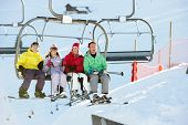 Teenage Family Getting Off chair Lift On Ski Holiday In Mountains