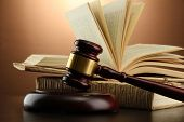 pic of court hammer  - wooden gavel and books on wooden table - JPG