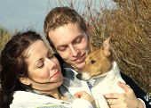 A Couple And Their Jack Russel