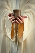 stock photo of communion-cup  - Hands of Jesus holding cup of wine - JPG