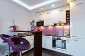 foto of oven  - Modern white and purple kitchen interior - JPG
