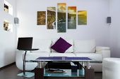 Modern lliving room interior with Cliffs of Moher canvas on the wall - it is my photo available in s
