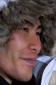 foto of eskimos  - man in outline who looks asian or inuit with coat above his head - JPG