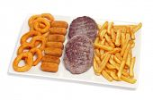 closeup of a spanish combo platter with burgers, croquettes, calamares and french fries