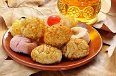 panellets, typical pastries of Catalonia, Spain, eaten in All Saints Day, and moscatel, a typical ca