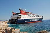 ALONISSOS, GREECE - SEPTEMBER 27, 2012: Hellenic Seaways ferry boat Express Skiathos docking at Pati