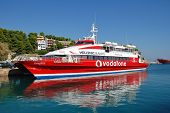ALONISSOS, GREECE - SEPTEMBER 27: Hellenic Seaways catamaran ferry Flying Cat 5 moored at Patitiri h
