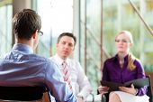 Man having an interview with manager and partner employment job candidate hiring resume CEO work