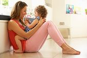 foto of mums  - Mother Sitting With Daughter At Home - JPG