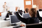 foto of adolescent  - group of high school students hands up in computer class - JPG