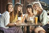 stock photo of friendship day  - Group of young women drinking coffee - JPG