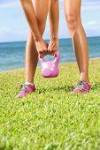 Kettlebell fitness training woman during exercise outside.
