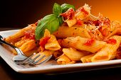 stock photo of grating  - Pasta with tomato sauce and parmesan - JPG