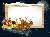 foto of rudolf  - Santa Christmas sleigh background with Santa riding in his sleigh delivering Christmas gifts - JPG
