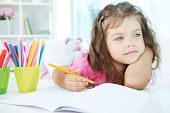 image of little school girl  - Portrait of lovely girl drawing with colorful pencils - JPG